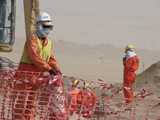 Workers in a sandstorm